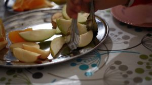 Keiraville preschool, children serve themselves fruit
